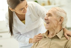 Trusted medical personnel acting supportive towards senior patient
