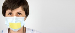 Truth About 2019 Novel Coronavirus 2019-nCoV . Medical secrecy concept. Woman doctor with taped lips in white uniform on white background. Pandemic. Panic. Information