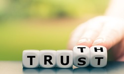 Truth instead of trust. Hand turns dice and changes the word