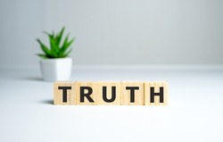 Truth - word from wooden blocks with letters, real facts truth concept, white background