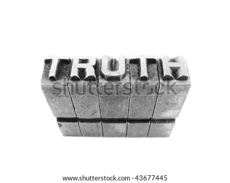 TRUTH written in metallic letters