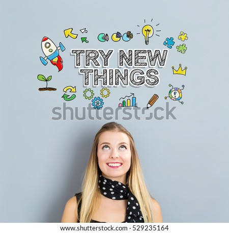 Try New Things concept with happy young woman on a gray background #529235164