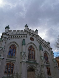 Tsar's stables in Petergof, built in the middle of the 19th century against the backdrop of a dramatic sky.