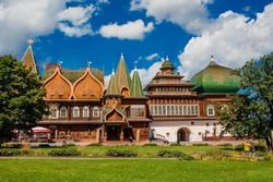 Tsar's wooden palace in Kolomenskoye park against the background of bright blue sky, Moscow, Russia. Sign on the wall is Refectory in Russian. Popular tourist attraction. Visiting card of Moscow.
