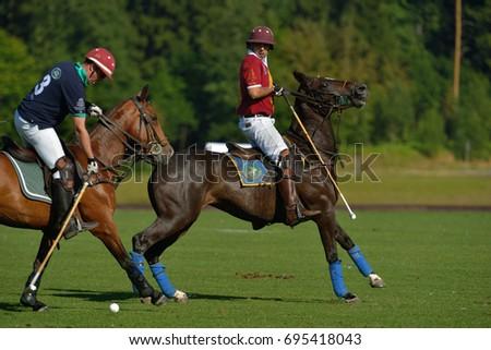 TSELEEVO, MOSCOW REGION, RUSSIA - JULY 26, 2014: Match Tseleevo Polo Club - Oxbridge Polo Team during the British Polo Day. Oxbridge won 5-4 #695418043