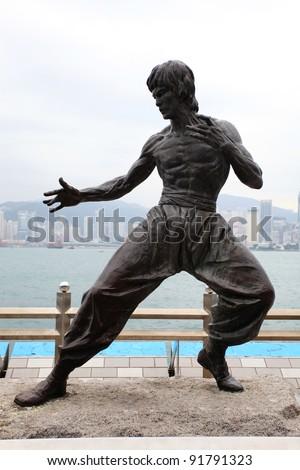 TSIM SHA TSUI, HONG KONG - NOVEMBER 20: Bruce Lee statue on the Avenue of Stars on November 20, 2011 in Tsim Sha Tsui. The statue is one of the main attractions on the famous waterfront promenade.