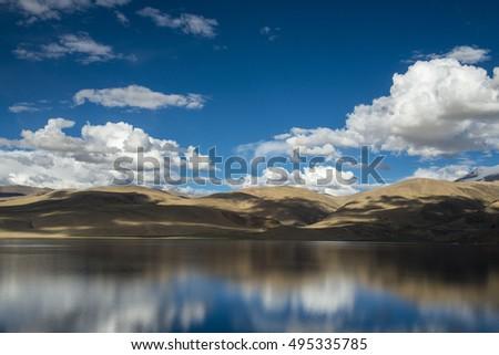 Tso Moriri lake near Karzok village in Rupshu valley against the background of blue sky - Leh district, Ladakh, Himalayas, Jammu and Kashmir, Northern India #495335785