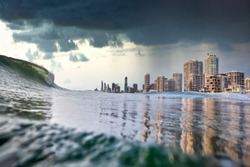 Tsunami king tide, dark stormy sky and rain approach the buildings of Surfers paradise, Gold Coast, Australia. Tsunami, King Tide or Cyclone concept