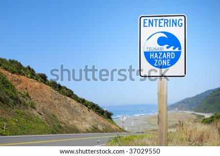 Tsunami warning zone road sign near ocean beach -- Harbor Wave