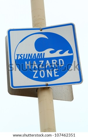 Tsunami zone warning sign (white cloud background)