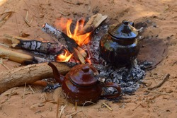 Tuareg, Touareg tea pot on a fire, Algeria, Sahara desert, North Africa