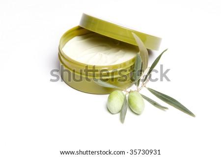Tub of olive body cream isolated - stock photo