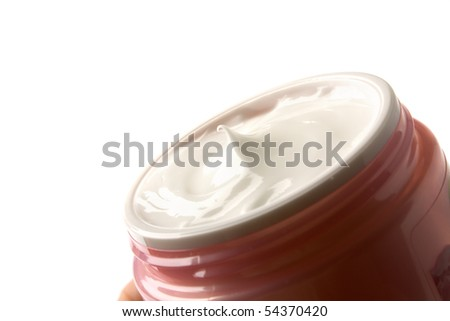 tub with a face cream with a red cover on a white background