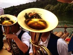 Tuba player at bavarian brass band during a tour at Munich.