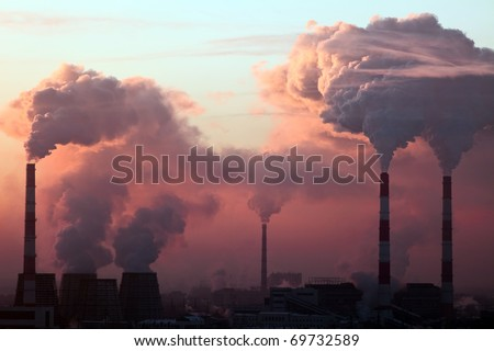 Tube with orange smoke on winter sunset