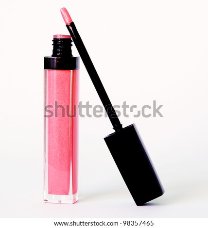 Tube with rose wet lipstick and brush