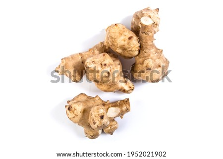 Tubers of Jerusalem artichokes close up, isolated on a white. Foto stock ©