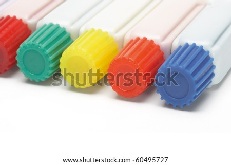 Tubes of multicolor paints lying on white background - stock photo