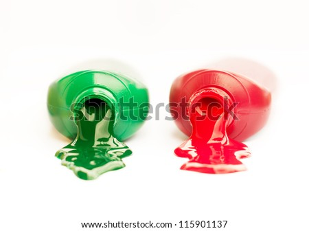 Tubes of red and green paint