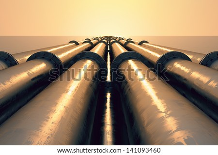 Tubes running in the direction of the setting sun. Pipeline transportation is most common way of transporting goods such as Oil, natural gas or water on long distances.