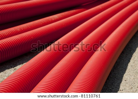 Tubing. Red plumbing pipe close-up. - stock photo