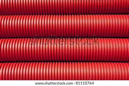 Tubing. Red plumbing pipe close-up.