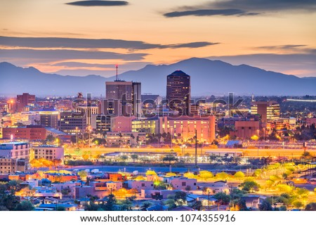 Tucson, Arizona, USA downtown skyline with Sentinel Peak at dusk.