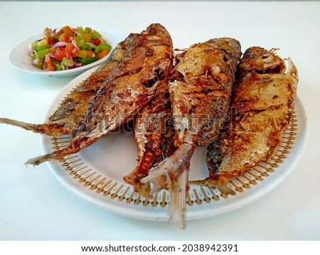Tude fish barbeque is manado traditional food with chili sauce. Photo stock ©