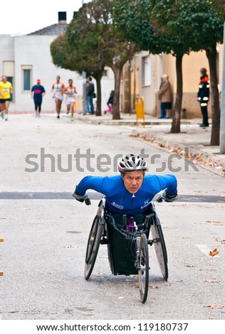TUDELA, SPAIN - NOVEMBER 18: unidentified runners participating in the 14 th race for the integration,  On november 18, 2012 in Tudela, Navarre,  Spain