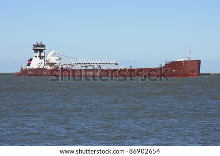 Tug and Barge:  A bulk carrier cargo vessel comprised of a self-unloading barge with a tug boat for power enters the Port of Cleveland, Ohio from Lake Erie