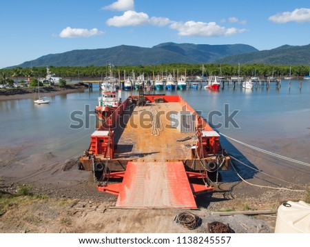 Tug and Barge combination on the ramp at the barge loading facility, Cairns, Queensland