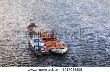 Tug and barge in the middle of the Volga River