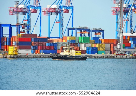Tugboat and crane in harbor quayside on Odessa, Ukraine