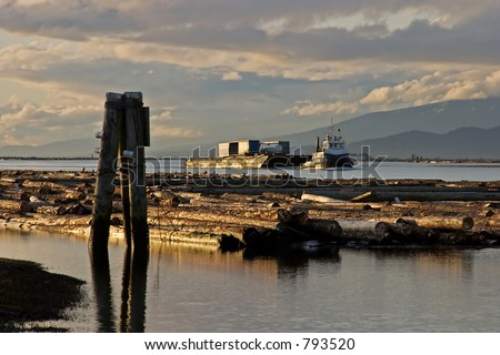 tugboat and logs on river