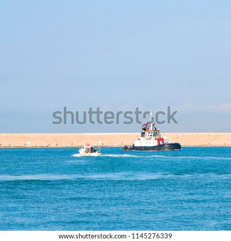 Tugboat entering the harbor