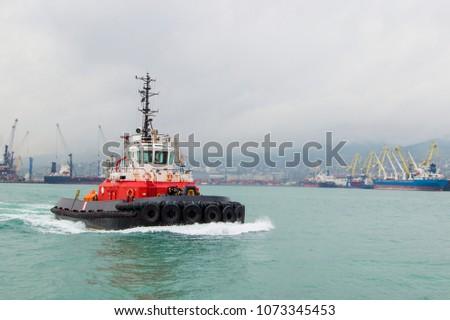 Tugboat Maneuvers, tugboat on maneuvers at sea.