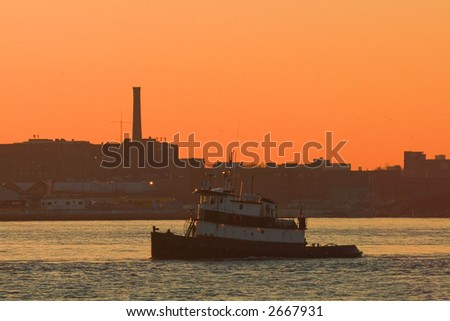 Tugboat on the East River at Dawn in New York City