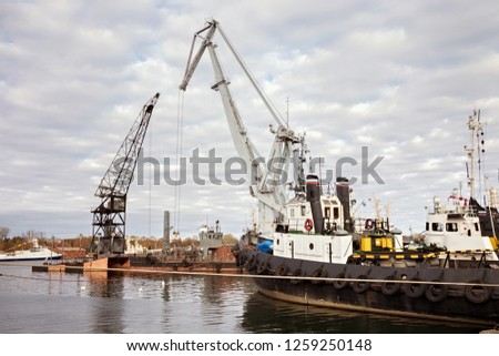 Tugboats and other marine support vessels in port. #1259250148