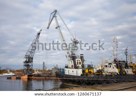 Tugboats and other marine support vessels in port. #1260671137