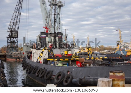 Tugboats and other marine support vessels in port. #1301066998