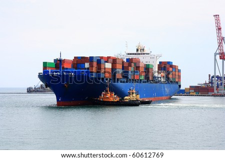 tugboats pulling  container vessel