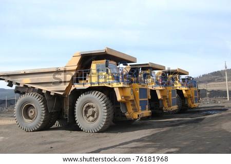 TUGNUI, RUSSIA - APRIL 2: Giant trucks are ready for coal transportation at the opening of Tugnuiskaya coal-preparation plant on April, 2, 2008 in Tugnui, Buryatia, Russia.