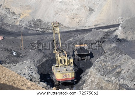 TUGNUI, RUSSIA - APRIL 2: The opening of Tugnuiskaya coal-preparation plant.  A mining shovel puts coal into a hauler, April, 2, 2008 in Tugnui, Buryatia, Russia.