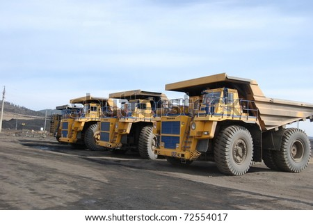 TUGNUI, RUSSIA - APRIL 2: The opening of Tugnuiskaya coal-preparation plant. Giant trucks are ready for coal transportation, April, 2, 2008 in Tugnui, Buryatia, Russia.