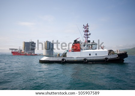 Tugs at the base of offshore oil drilling platform. Sea Japan. Russian coast.