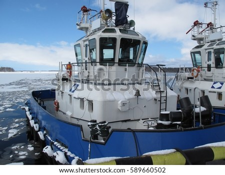 Tugs in port, Vysotsk city 2014 year #589660502