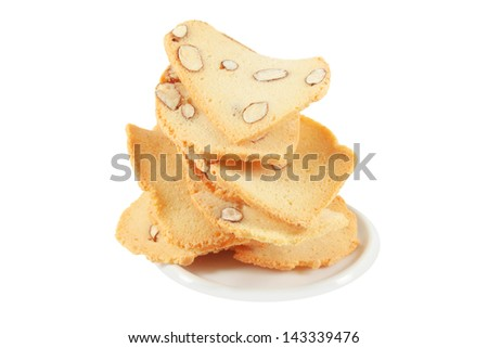 Tuile, cookie with almond, pyramid, isolated on white background