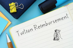 Tuition Reimbursement sign on the piece of paper.