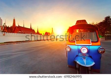 tuk tuk and sun set sky at grand palace most popular traveling destination in bangkok thailand
