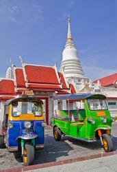 Tuk Tuk car and temple in Bangkok, Thailand